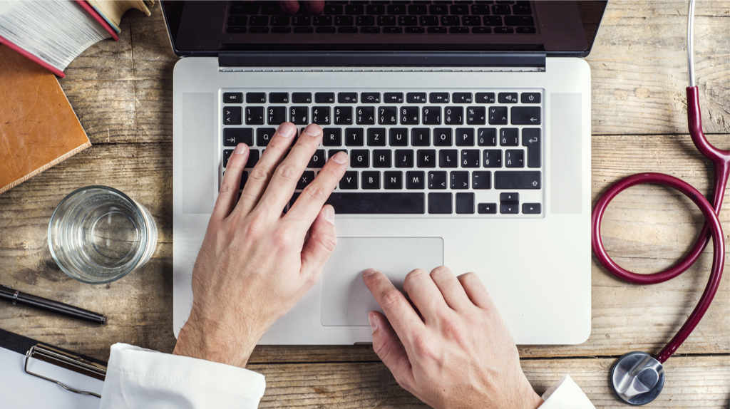 Hands of a man on a laptop